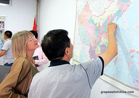 Jancis Robinson checks a map of China.
